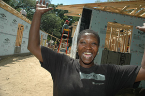 Fannie Munson celebrates her new Habitat house during the Baptist Build construction blitz.