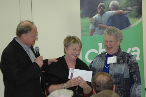 Pastor Larry Haun (left) and member Jean English (right) present Paynter with gift to support CBF ministries.