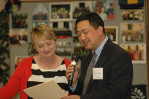 Pastor Michael Cheuk presents Suzii Paynter with letter affirming the partnership of University Baptist Church with CBF.