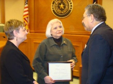 Paynter (l) & Reyes (r) present Texas Sen. Judith Zaffirini with CLC award. Feb. 21, 2012.