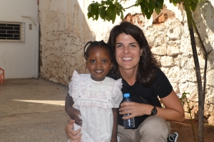 Shawna Stomberg, a member of Lexington Avenue Baptist Church in Danville, Ky., poses with a child from Lexington Avenue's partner congregation in Rabat, Morocco during the 2011 Fellowship Without Borders trip.