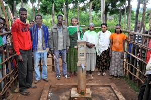 The community-elected Water Use Committee celebrates their village's new drill. The WUC is responsible for water management, fee collection and pump repair.