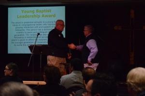 Jeffrey Pethel accepts the Jack Naish Christian Educator Award.