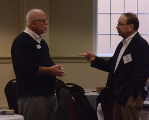 Bo Prosser converses with consultant, Mike Queen during a break.