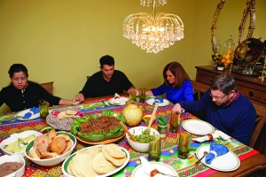 """CBF field personnel Greg and Sue Smith (pictured right) share a meal and fellowship. In the Latino community, fellowship and community is often built around food and the sharing of a meal. """"Food is the prop for the fellowship that you share with each other,"""" Greg Smith said."""