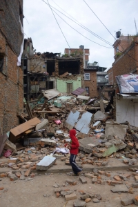 A boy stands in the rubble in the aftermath of the earthquake in Nepal. Image via BMS World Mission.