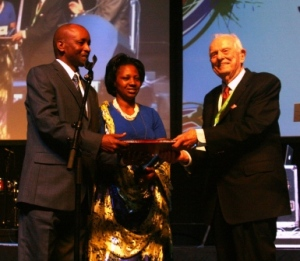 Corneille Gato Munyamasoko of Rwanda, accompanied by wife, Anne Marie, accepts the BWA Congress Human Rights Award from David Maddox, a longstanding BWA committee and commission member and supporter