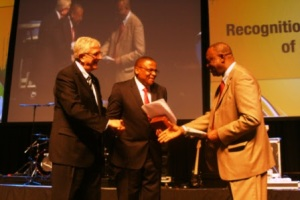 New BWA President Paul Msiza of South Africa (center) being congratulated by outgoing President John Upton (left) and General Secretary Neville Callam