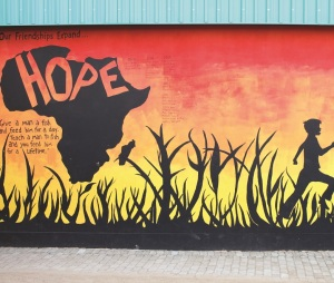 A mural painted on the wall of an activity center at Refilwe Community Project in the Lanseria district, north of Johannesburg, South Africa.