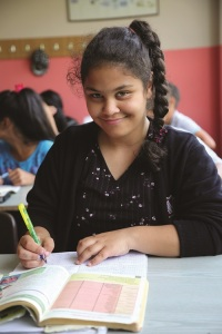 Estera knows that there are benefits of an education that extend beyond the fifth grade and help the entire family.