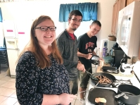 Students from the Raleigh Cooperative Baptist Student Fellowship cook a meal for the larger group at a recent Fall Spiritual Formation Retreat.